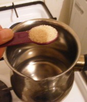 Dissolve the sugar into 1/2 cup lukewarm water
