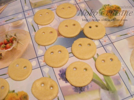 using a straw, make to little holes - the eyes of the cookies