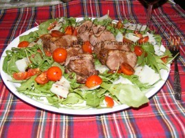 arrange a bed of rocket and add the slices of meat